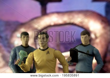 Star Trek scene with Captain Kirk, Mr Spock & Dr McCoy action figures standing in front of the Guardian of Forever time portal.