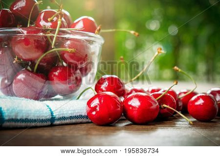 Cherries. Cherry. Red cherry in glass bowl on kitchen napkin. healthy food concept