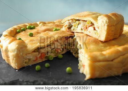 Slate plate with delicious turkey pot pie, closeup