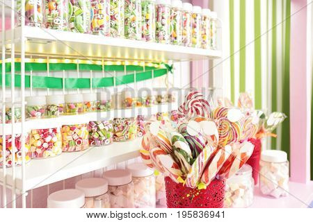 Different sweets on counter at candy shop