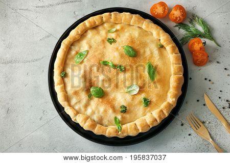 Baking dish with turkey pot pie on light background
