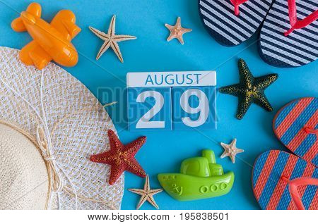 August 29th. Image of August 29 calendar with summer beach accessories and traveler outfit on background. Summer day, Vacation concept.