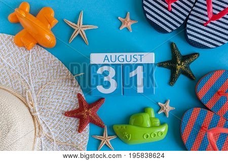 August 31st. Image of August 31 calendar with summer beach accessories and traveler outfit on background. Summer day, Vacation concept.