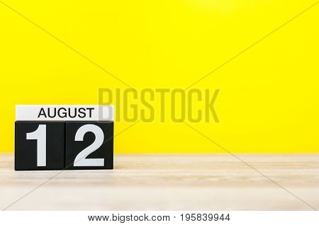 August 12th. Image of august 12, calendar on yellow background with empty space for text. Summer time.