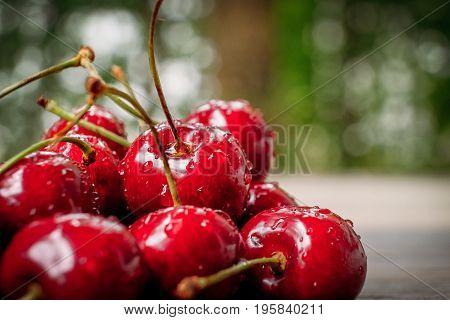 Cherries in wooden basket on sackcloth. healthy food concept