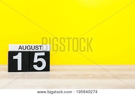 August 15th. Image of august 15, calendar on yellow background with empty space for text. Summer time.