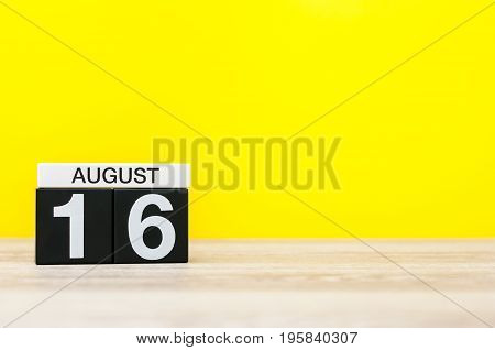August 16th. Image of august 16, calendar on yellow background with empty space for text. Summer time.
