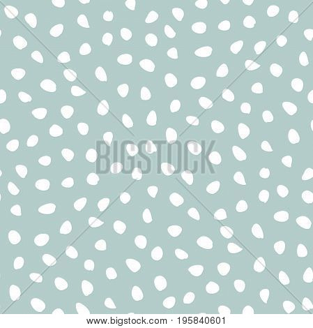 Seamless vector background with random white elements. Abstract ornament. Dotted abstract pattern