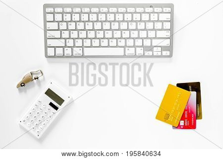 Buying car. Car keys near keyboard on white background top view.
