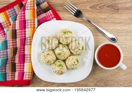 Boiled Khinkali With Dill In Plate, Tomato Juice, Napkin