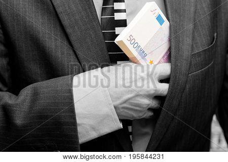 A Man Hides A Bundle Of Money In His Pocket