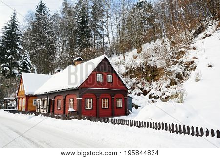 Winter hamlet with snow in the Czech Switzerland