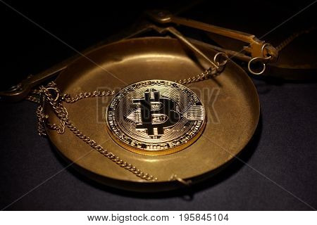 Golden Bitcoin Coin and scales copper. Bitcoin cryptocurrency. Business concept.