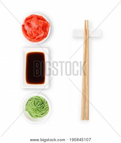 Set of sushi tablewear. Top view on saucer with soy sauce, small white bowls for ginger and wasabi and chopsticks at white background. Flat lay, copy space