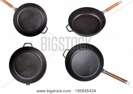 empty cast-iron frying pan isolated on white background