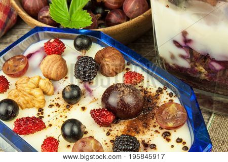 Vanilla pudding with summer fruit on a wooden table. Healthy snacking for kids