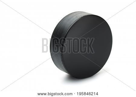 Ice hockey puck isolated on white