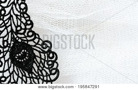Detail of black lace on white tulle closeup vintage wedding background space for text