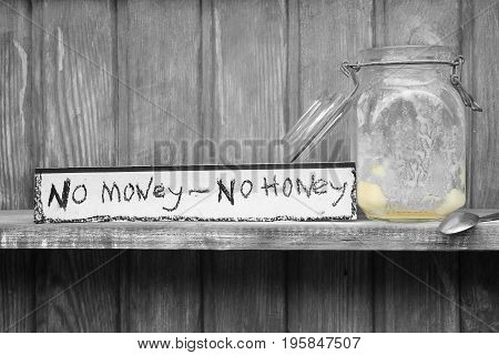No money - no honey text on a paper next to empty jar selective photo concept of life situations