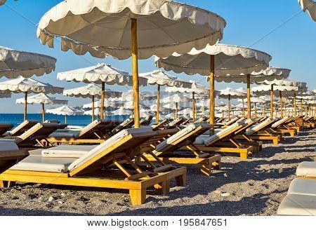 big sunbeds and sunshades on the beach closeup