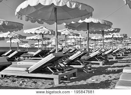 beach sunbeds and sunshades closeup of monochrome tone