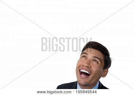 Close up of happy businessman looking up against white background