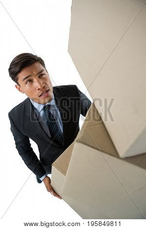 High angle view of businessman carrying cardboard boxes against white background