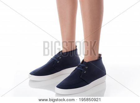 Man feet wearing blue fashion shoes in hipster style standing with side view Isolated on white background Men's Fashion concept.