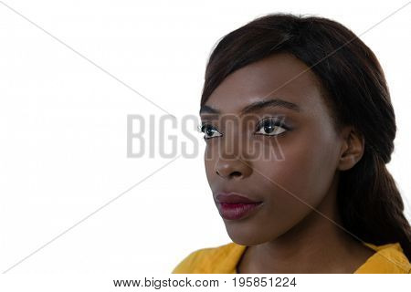 Close up of contemplated young woman against  white background