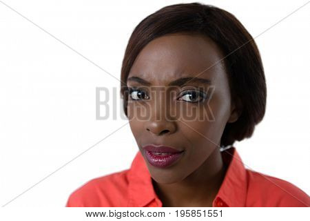 Close up portrait of confused young woman against white background