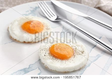 Homemade sunny side up fried eggs on plate