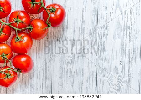 Prepring for cooking dinner. Tomato on wooden table background top view copyspace.