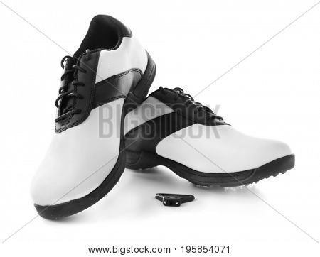 Modern golf shoes on white background