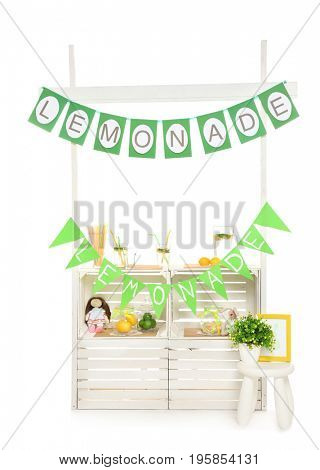 Lemonade stand with decor on white background