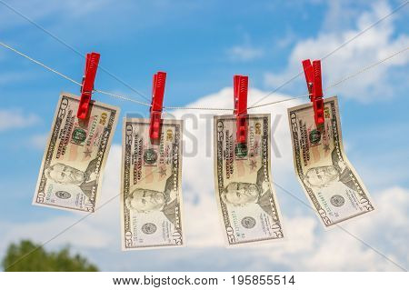 Dollars laundered dried against the sky .