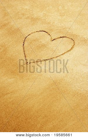 Heart shape drawn in sand on a beach