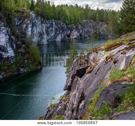 Marble quarry in Ruskeala Park in Republic of Karelia, Russia. Ruskeala - tourist center, located on the ground filled with groundwater former marble quarry.