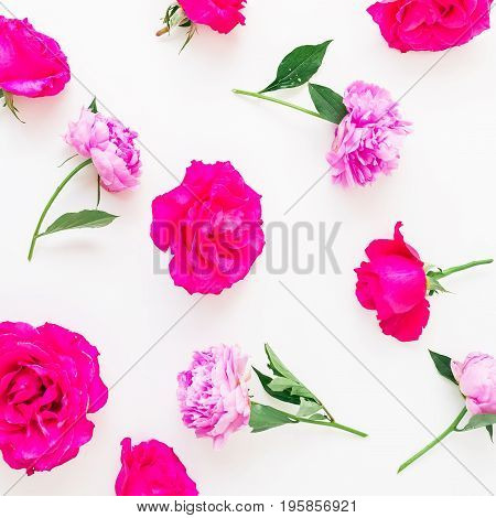 Floral pattern made of peony and pink roses on white background. Flat lay, top view