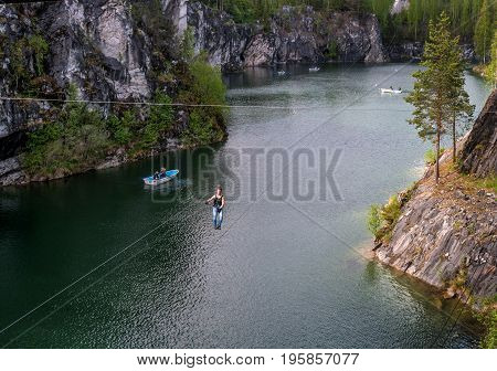Ruskeala, Sortavala, Republic of Karelia, Russia - June 12, 2017: Marble quarry in Ruskeala Park. Ruskeala - tourist center. Tourists descend on Ziplin .