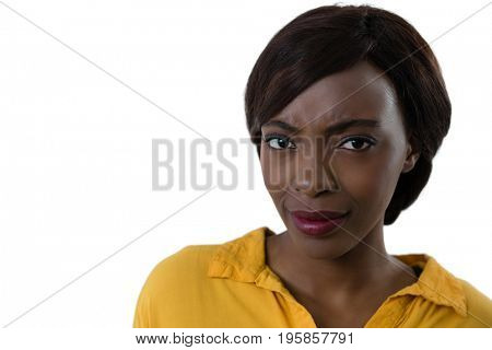 Close up portrait of confused woman against white background