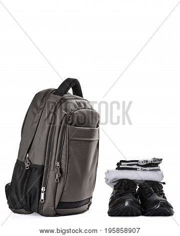 Fitness bag with gym shoes, white towel and gloves
