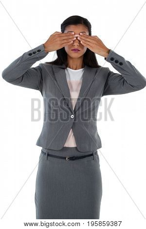 Businesswoman covering her eyes. See no evil concept