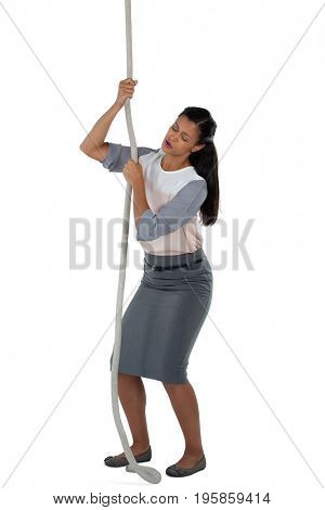 Businesswoman climbing the rope against white background