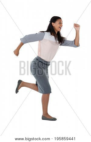 Side view of businesswoman running against white background