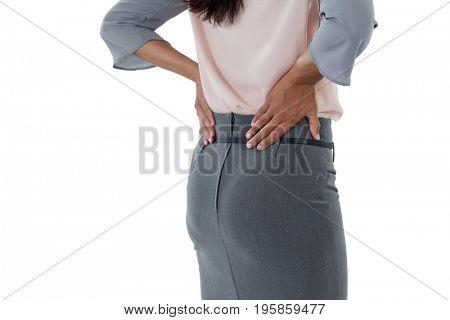 Mid section of businesswoman having an backache