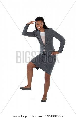 Portrait of excited businesswoman dancing against white background