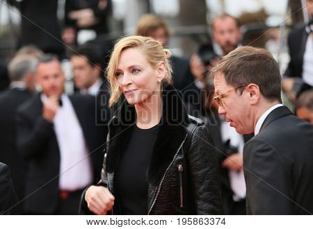 Uma Thurman, Reda Kateb attend the 'Nelyobov (Loveless)' screening during the 70th Cannes Film Festival at Palais des Festivals on May 18, 2017 in Cannes, France.