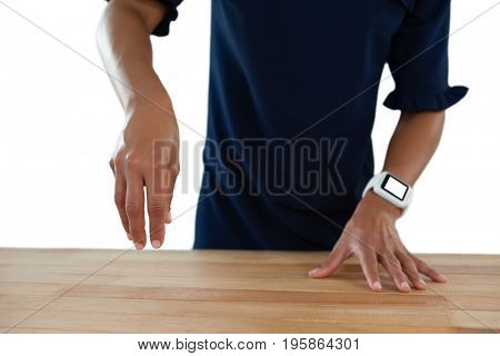 Mid section of businesswoman pretending to work on an invisible object