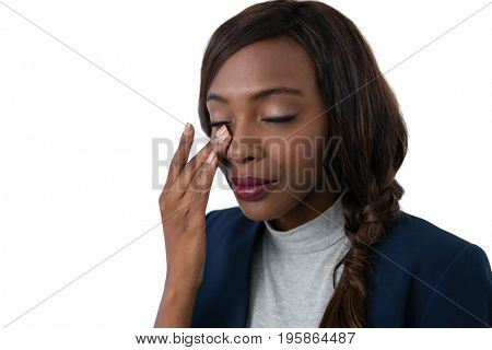 Close up of businesswoman rubbing eyes against white background