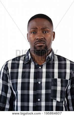 Portrait of confused man against white background